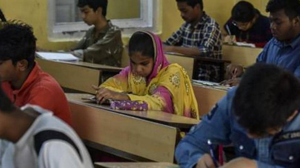 Students appear for exam at an examination centre