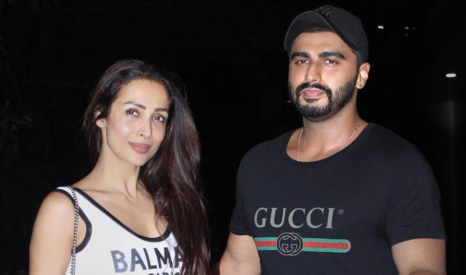 Arjun Kapoor and Malaika Arora pose for photos as they arrive to watch the screening of India's Most Wanted, in Mumbai.