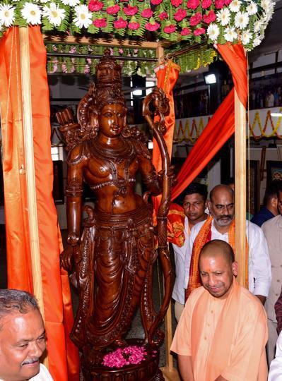 Uttar Pradesh Chief Minister Yogi Adityanath with the newly unveiled seven-foot tall statue of Lord Rama at Ayodhya Shodh Sansthan.