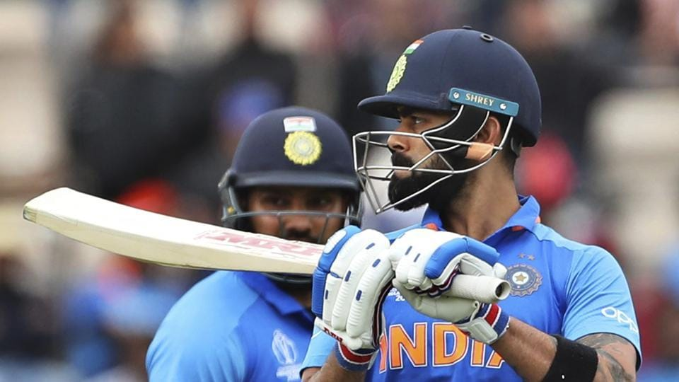 India's Rohit Sharma, left, watches captain Virat Kohli react after being dismissed during the Cricket World Cup match between South Africa and India at the Hampshire Bowl in Southampton, England, Wednesday, June 5, 2019. (AP Photo/Aijaz Rahi)