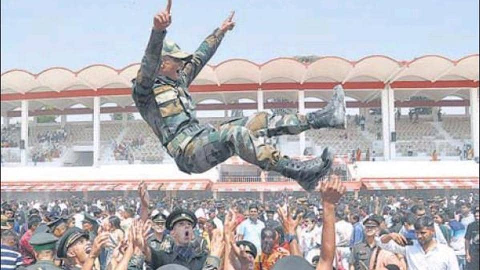 Gentleman Cadets celebrate their commissioning in the Indian Army at IMA in Dehradun on Saturday.