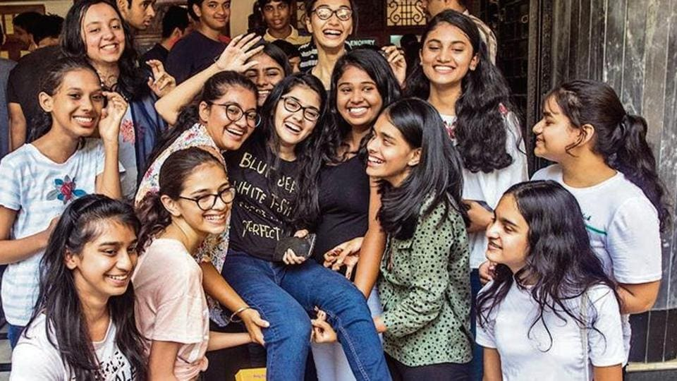 Topper of Balmohan Vidyamandir Anushka Phadnis along with other students celebrate their success after SSC results came out at Dadar in Mumbai.