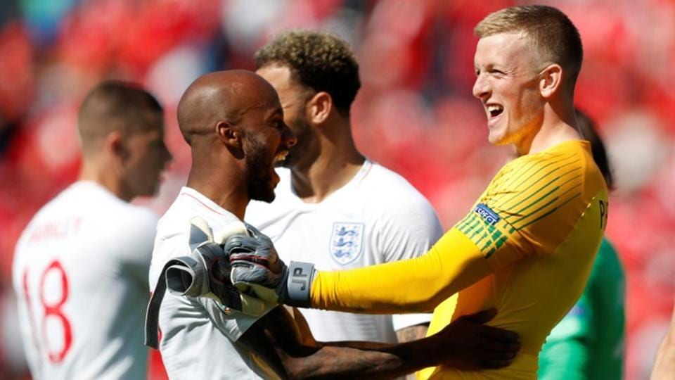 England's Jordan Pickford celebrates with Fabian Delph after the match.