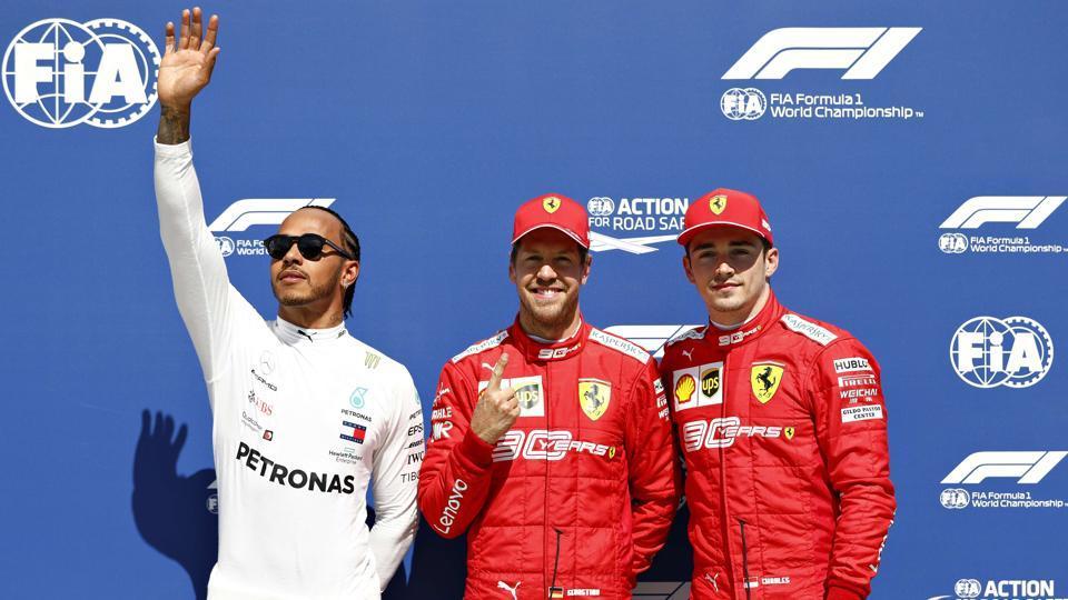 Top three qualifiers Sebastian Vettel of Germany and Ferrari, Lewis Hamilton of Great Britain and Mercedes GP and Charles Leclerc of Monaco and Ferrari.