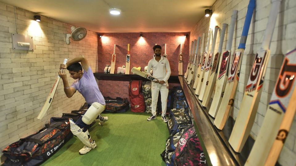 A boy practises a shot at an indoor cricket learning centre, in Malviya Nagar, New Delhi. Away from the scorching heat of Delhi summers, these indoor cricket facilities have become popular among young cricket aspirants and corporate cricket enthusiasts. Many pay-and-play indoor cricket establishments that have sprung up across Delhi-NCR over the past year, giving rise to an indoor cricket coaching culture in the city, and attracting players from far and wide. (Burhaan Kinu / HT Photo)