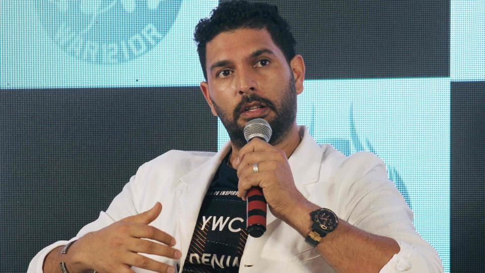 Indian cricketer Yuvraj Singh speaks during a news conference.
