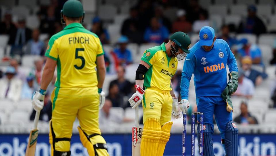 Australia's David Warner (C), Australia's captain Aaron Finch (L) and India's Mahendra Singh Dhoni look on after the ball touched his stumps but did not dislodge the bails during the 2019 Cricket World Cup group stage match between India and Australia at The Oval in London on June 9, 2019