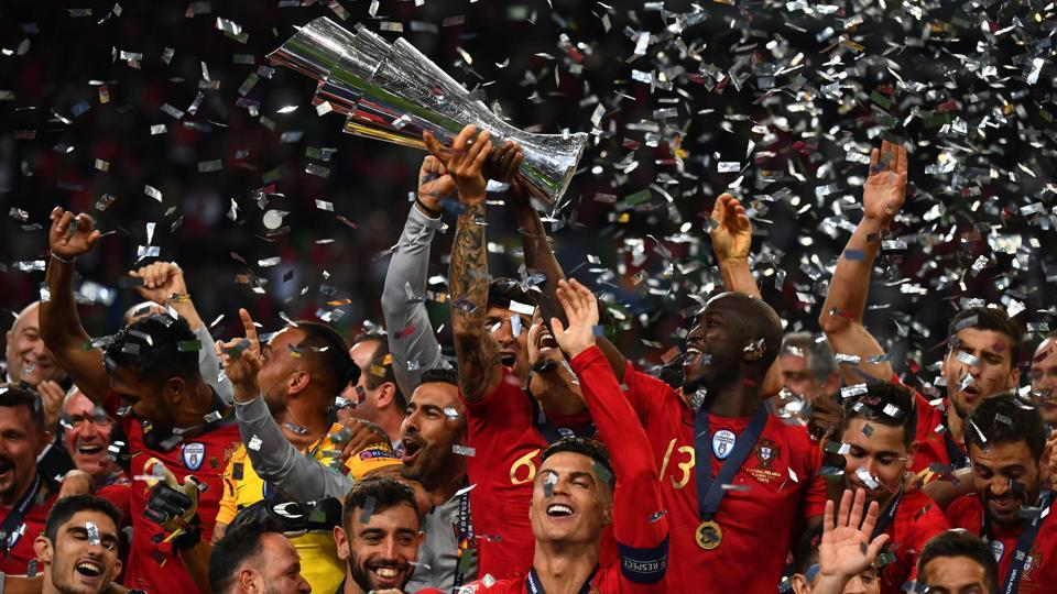 Portugal's forward Cristiano Ronaldo (front C) celebrates with teammates after the UEFA Nations League final football match between Portugal and The Netherlands at the Dragao Stadium in Porto on June 9, 2019