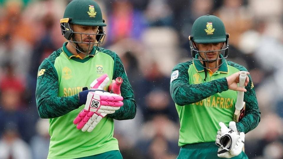 South Africa's Faf du Plessis and Quinton de Kock walk off the field as rain stops play.