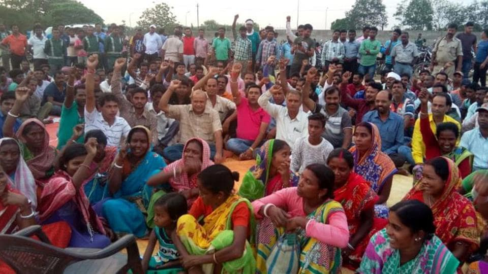 Affected family members demonstrate near Maithon Power Limited in Dhanbad on Saturday.