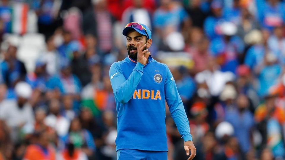 India's captain Virat Kohli speaks to his players on the field in the 2019 Cricket World Cup group stage match between India and Australia at The Oval in London on June 9, 2019