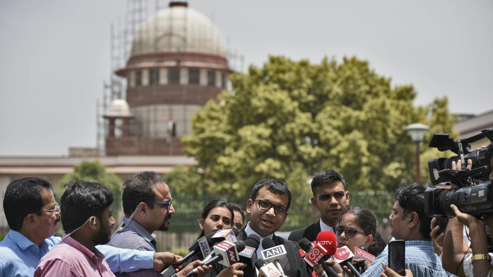 Lawyers along with Jagisha Arora, wife of journalist Prashant Kanojia, speak to journalists after the Supreme Court ordered immediate release of journalist Kanojia who was arrested for sharing a post against Uttar Pradesh chief minister Yogi Adityanath. (Burhaan Kinu / HT Photo)