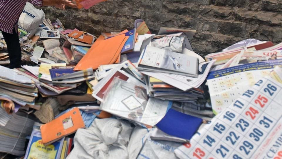 paper waste collection,Indian boy collects paper waste in Dubai