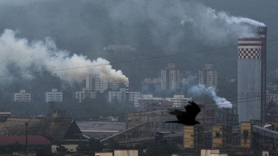 Smoke comes out from a Refinery factory at Sewri in Mumbai.