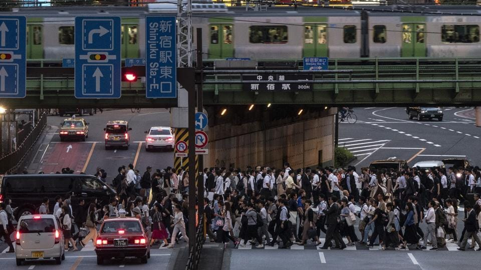 A Yamanote Line train travels above commuters walking across the crossing during evening rush hours in the Shinjuku district of Tokyo. For most Tokyoites, the line is an incredibly punctual and efficient transportation system for commuting. For tourists, it offers a glimpse into the lives of ordinary people in many of the city's neighborhoods. (Jae C. Hong / AP)