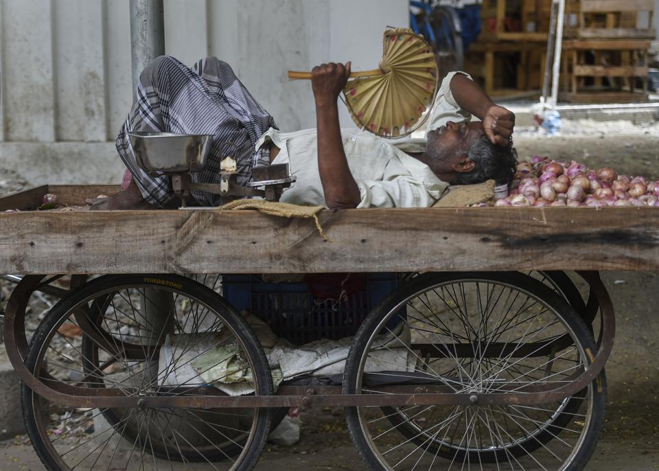 A vegetable seller takes rest on cart as the Chennai city reels under a heat wave on June 10, 2019. Heatwave conditions in the national capital are set to end on Tuesday following rains in the evening, bringing much needed respite from the scorching heat. According to the India Meteorological Department, light rains are expected in the evening owing to a cyclonic circulation over Rajasthan and moisture-laden winds from the Arabian sea. (PTI)