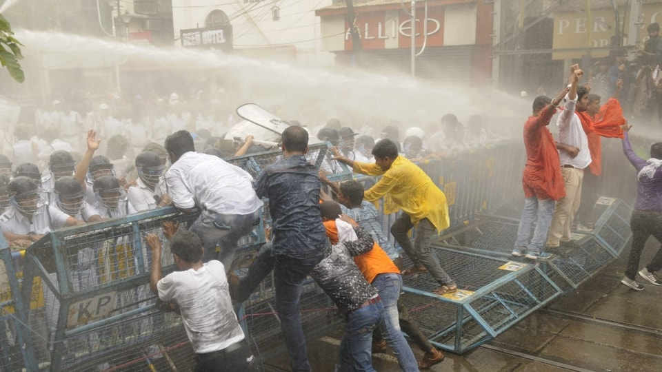 Police  use water canons to disperse BJPworkers as they try to push through a layer of barricade  near the Kolkata Police headquarters.