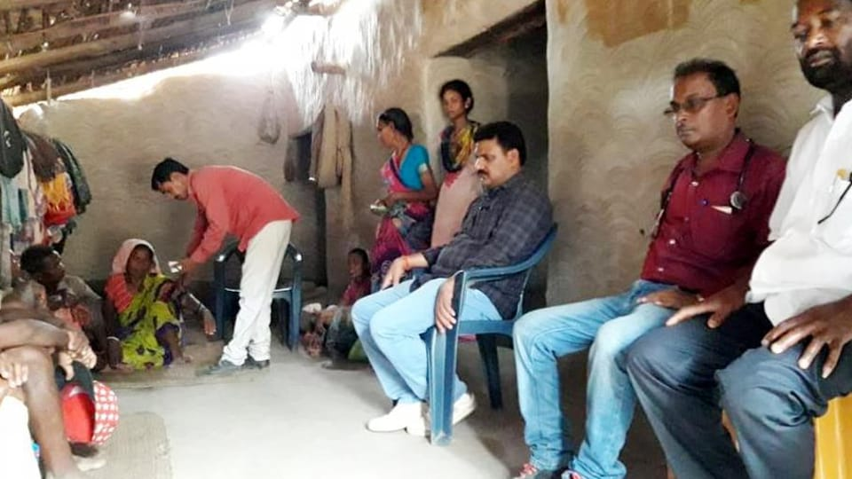 Team of officials at the residence of Ramcharan Munda ,who allegedly died of hunger in Latehar district.