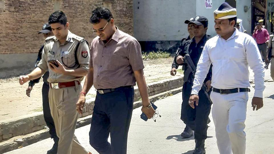 Administration officials visit the Tappal area in the aftermath of the murder of a two-and-a-half-year-old girl, in Aligarh, Sunday, June 9, 2019.