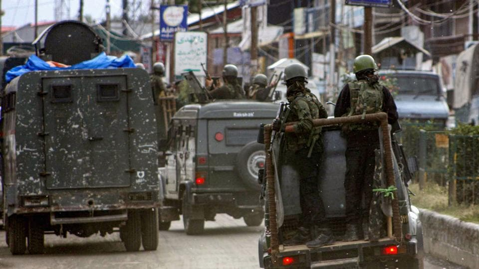 Security personnel near the site of 'Fidayeen' attack, in which five CRPF personnel and one militant were killed and four others including an SHO were injured, in Anantnag,  on June 12, 2019.