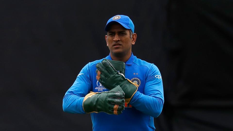 India's wicketkeeper Mahendra Singh Dhoni prepares to receive the ball during the 2019 Cricket World Cup group stage match between India and Australia at The Oval in London on June 9, 2019.
