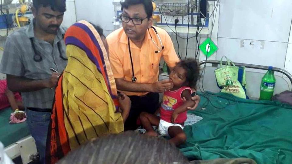 Doctors treat a child suspected to be suffering from acute encephalitis syndrome in Muzaffarpur on Wednesday.