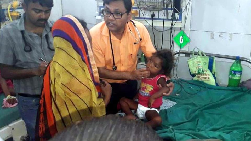 Doctors treat children after they found a symptom of Acute Encephalitis syndrome in Muzzafarpur on Wednesday, June 12, 2019.
