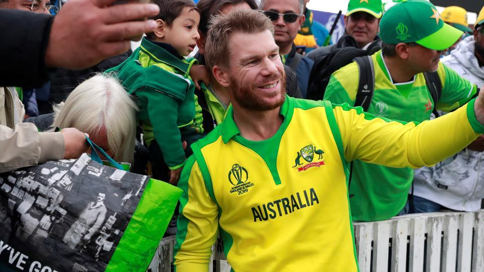 Australia's David Warner poses for a photo with fans after the match.