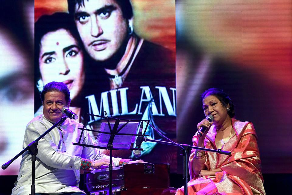 Anup Jalota and veteran Bollywood playback singer Usha Timothy perform during a live concert in Mumbai.