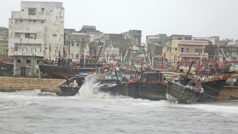 Fishing boats bombard on a wall due to heavy winds and huge waves in the Arabian sea at Veraval. (Ajit Solanki / AP)