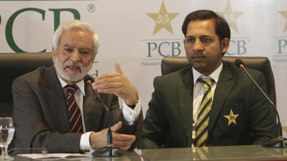 Chairman Pakistan Cricket Board Ehsan Mani, left, addresses a news conference with Sarfraz Ahmed in Lahore, Pakistan, Tuesday, Feb. 5, 2019. The PCB on Tuesday confirmed Ahmed as captain of the national team to the Cricket World Cup in England.