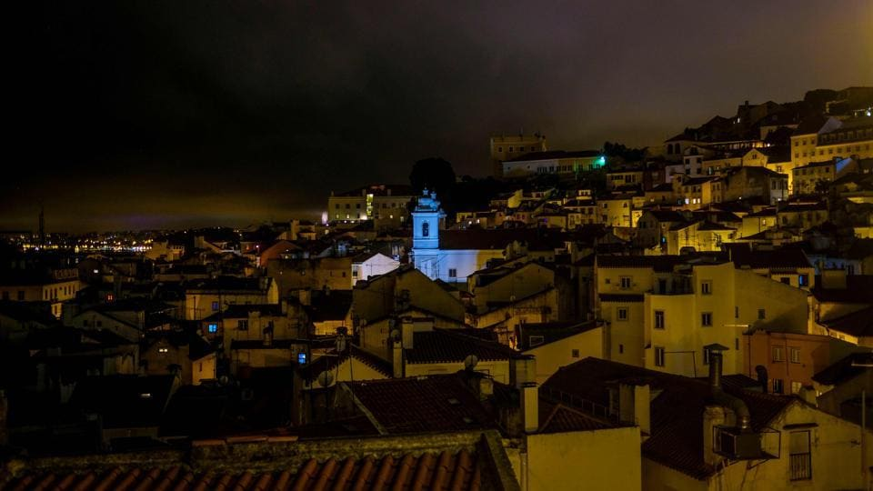 Madonna moved to the Portuguese capital in 2017, so that her son David Banda could attend the Benfica football academy, where he is enrolled.This photograph shows a general night view of the Alfama neighbourhood in Lisbon.  (Patricia De Melo Moreira / AFP)