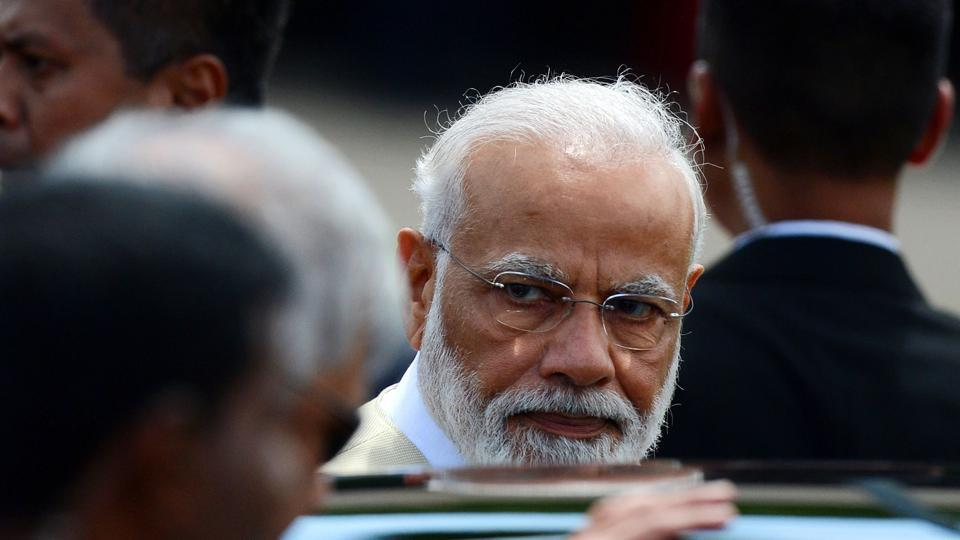 Indian Prime Minister Narendra Modi looks on upon arriving at Bandaranaike International airport in Katunayake on the outskirts of Colombo on June 9, 2019. (Photo by ISHARA S. KODIKARA / AFP)