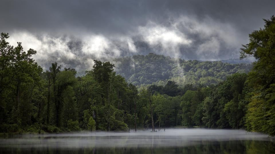 Morning clouds clear out as sunlight breaks through on the ridges above the Holston River in Sullivan County Tennessee, in Bristol, England. (Andre Teague, Bristol Herald Courier / AP)