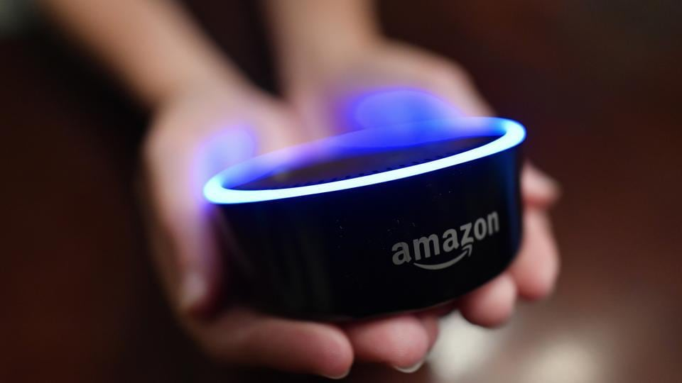 In this Aug. 16, 2018, file photo a child holds his Amazon Echo Dot in Kennesaw, Ga. Amazon met with skepticism from some privacy advocates and members of Congress last year when it introduced its first kid-oriented voice assistant , along with brightly colored models of its Echo Dot speaker designed for children.