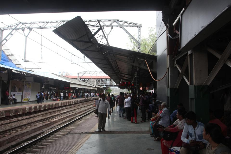 A section of Thane station's platform number 2 with the roof missing, which leads to water gushing down during rain.