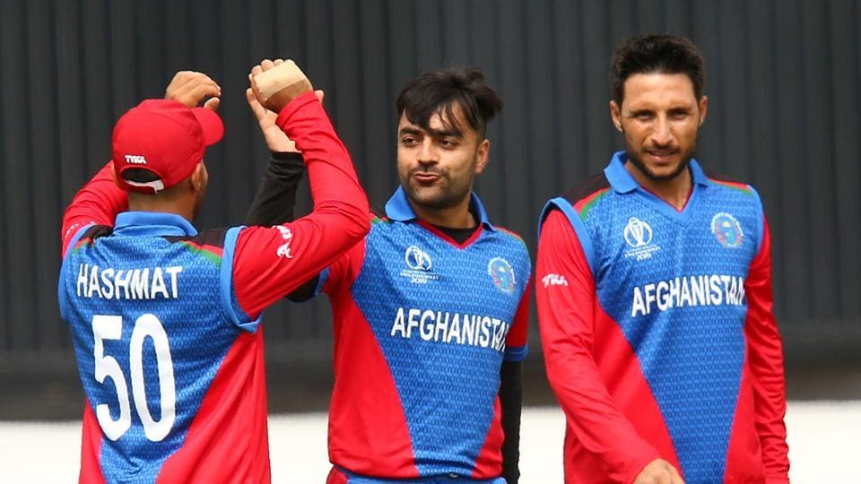 Afghanistan's Rashid Khan (C) celebrates with teammates after bowling Sri Lanka's Nuwan Pradeep for a duck during the 2019 Cricket World Cup group stage match between Afghanistan and Sri Lanka at Sophia Gardens stadium in Cardiff, south Wales, on June 4, 2019.