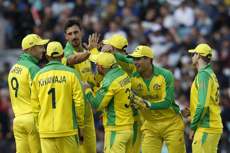 Australia's Mitchell Starc celebrates with teammates after taking the wicket of Sri Lanka's Thisara Perera. (AFP)