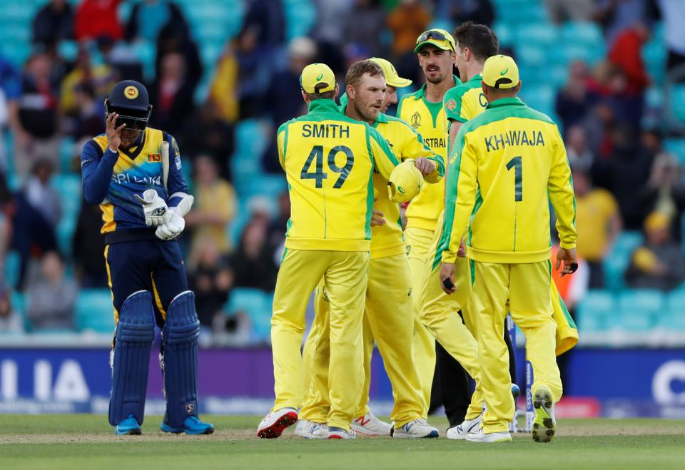 Australia's Aaron Finch, Steven Smith and team mates celebrate winning the game against Sri Lanka. (Action Images via Reuters)