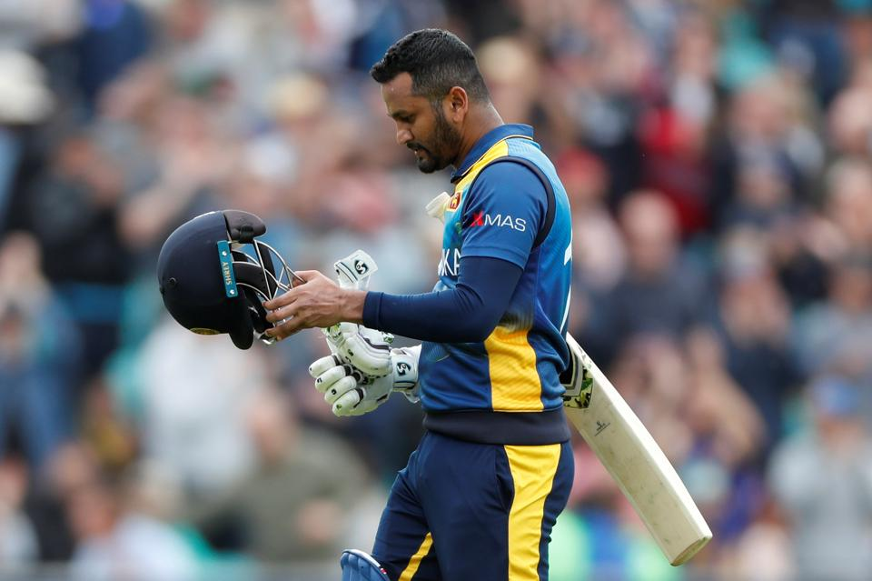 Sri Lanka's Dimuth Karunaratne looks dejected as he walks off the pitch after being caught out by Glenn Maxwell. (Action Images via Reuters)