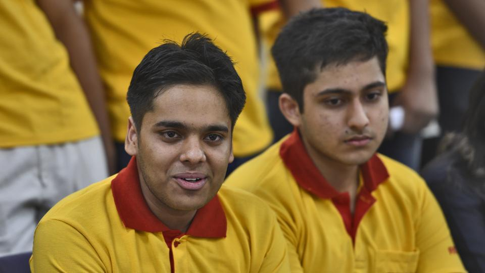 Second and third toppers Himanshu Gaurav Singh (L) and Archit Bubna
