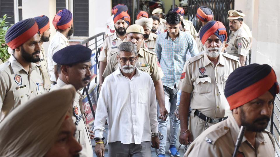 Sanji Ram and Parvesh Kumar, convicted in the Kathua rape and murder case, leave the District Court after it sentenced them to prison terms at Pathankot in Punjab. Six men were found guilty by the court. (Sameer Sehgal / HT Photo)