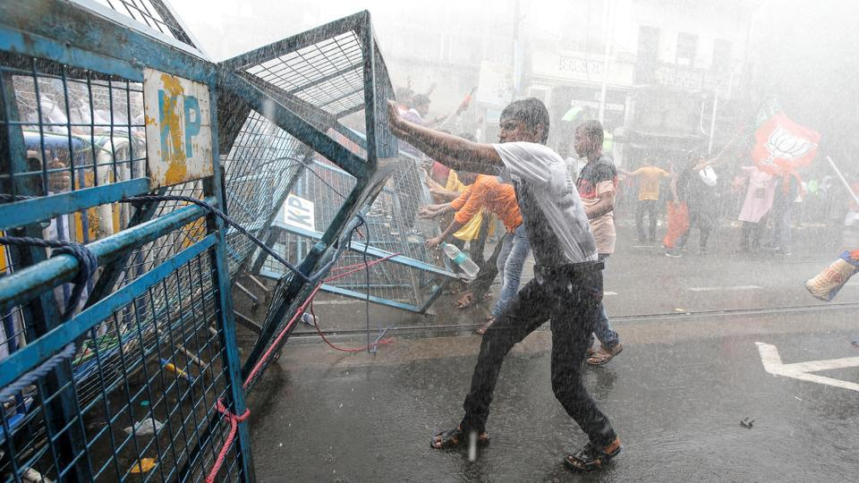 Supporters of India's Bharatiya Janata Party (BJP) break barricades as police use water cannon to disperse them during a protest against what they call violence against their party workers in their state, in Kolkata, West Bengal.  (Rupak De Chowdhuri / REUTERS)
