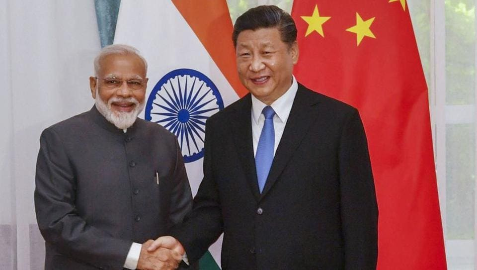 Prime Minister Narendra Modi shakes hands with Chinese President Xi Jinping on the sidelines of the Shanghai Cooperation Organisation (SCO) Summit in Bishkek, Kyrgyzstan. (PTI File Photo)