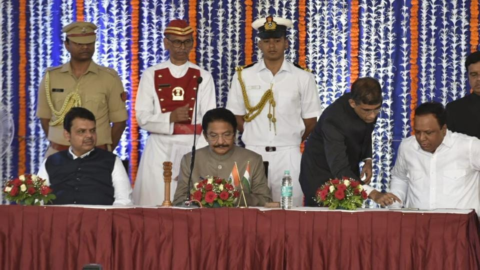 Newly sworn minsiter Ashish Shelar with Maharashtra governor Vidyasagar rao and CM Devendra Fadnavis at Raj Bhavan in Mumbai.