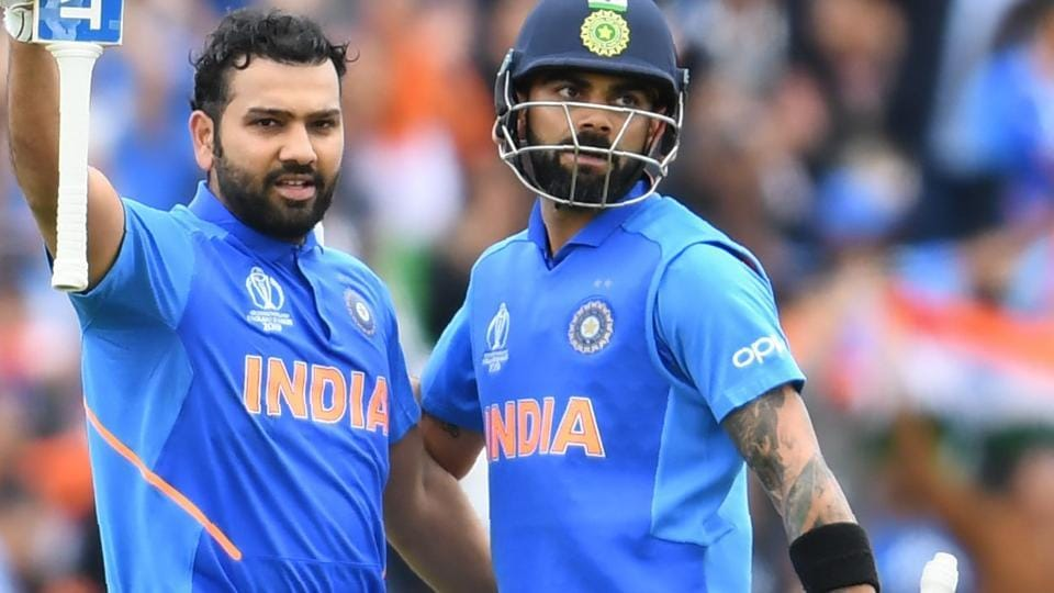Rohit Sharma (L) celebrates with captain Virat Kohli after scoring a century (100 runs) during the 2019 Cricket World Cup group stage match between India and Pakistan at Old Trafford in Manchester, northwest England.