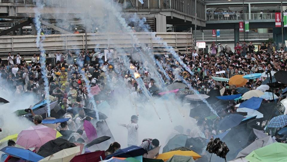 September 28, 2014: Riot police launched tear gas into the crowd as thousands of protesters surrounded the government headquarters in Hong Kong. A series of steps by the Chinese and Hong Kong governments in recent years have prompted a growing uneasiness among Hong Kong residents about their future. Protesters seeking direct elections for Hong Kong's leader laid siege to government headquarters for 79 days but fail to win any concessions. (Wally Santana / AP File)