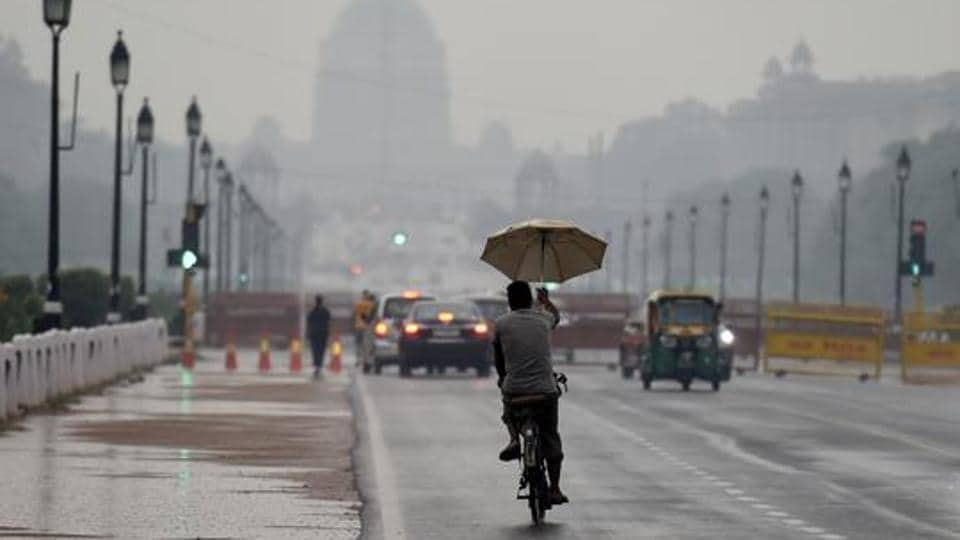 Light rainfall on Sunday brought respite from the intense heat in the national capital, with the minimum temperature recorded at 28.2 degrees Celsius, the season's average.