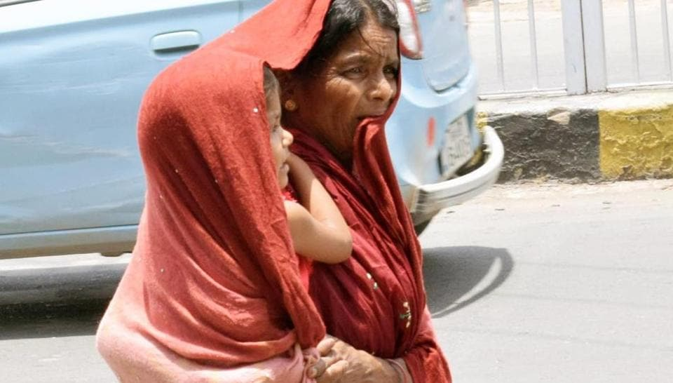 A woman covers herself and her child  in Patna  on Saturday which was the hottest in the city in ten years.