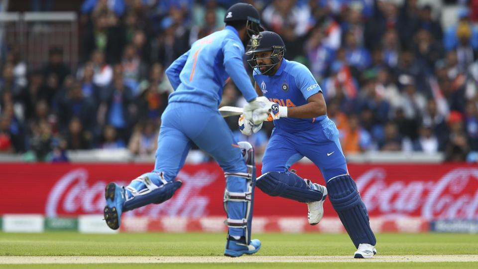 India's KL Rahul, left, and India's Rohit Sharma run between wickets.